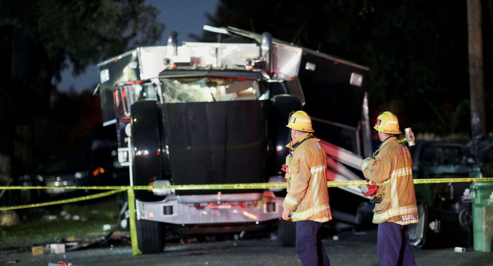 A damaged vehicle is seen at the site of an explosion after police attempted to safely detonate illegal fireworks that were seized, in Los Angeles, California, U.S., June 30, 2021