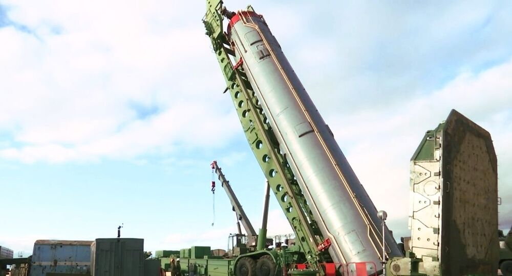 An intercontinental ballistic missile of the Avangard strategic missile system being installed in a silo in the Orenburg region.