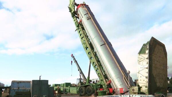 An intercontinental ballistic missile of the Avangard strategic missile system being installed in a silo in the Orenburg region. - Sputnik International