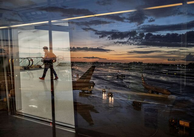 A passenger arrives at terminal D of Miami International Airport after heavy rains, as Hurricane Elsa moves towards south Florida, in Miami, U.S. July 2, 2021.