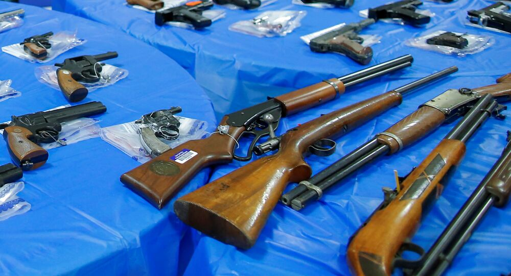 Guns are displayed after a gun buyback event organized by the New York City Police Department (NYPD), in the Queens borough of New York City, U.S., June 12, 2021.
