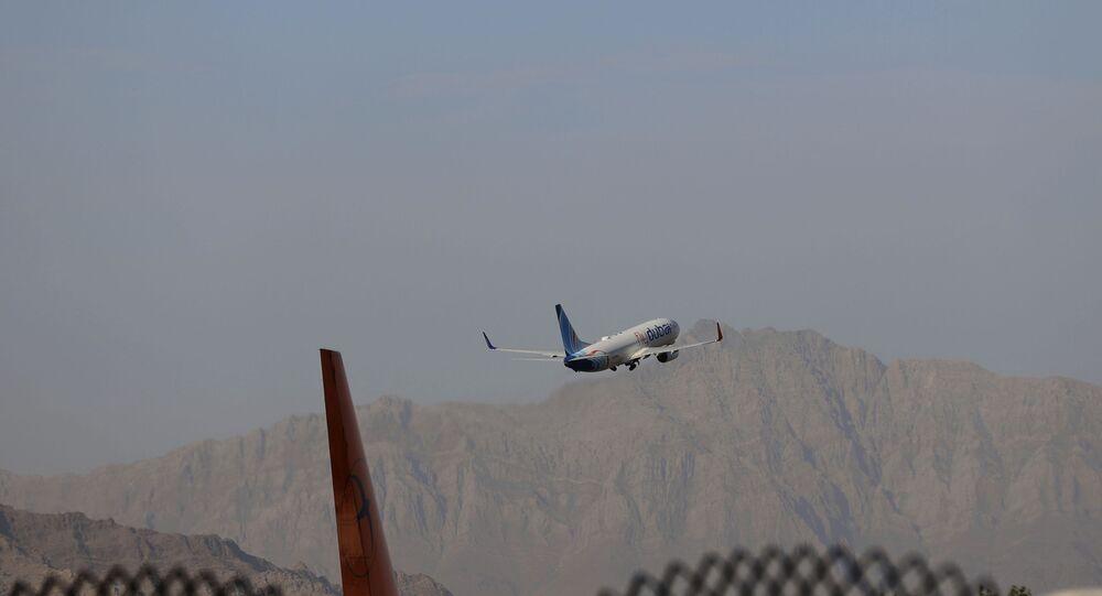 A fly Dubai plane departs Hamid Karzai International Airport in Kabul, Afghanistan, Sunday, July 4, 2021.