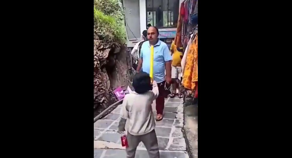 Poor little Kid on the streets of Dharamshala asking EDUCATED people where their masks are.
