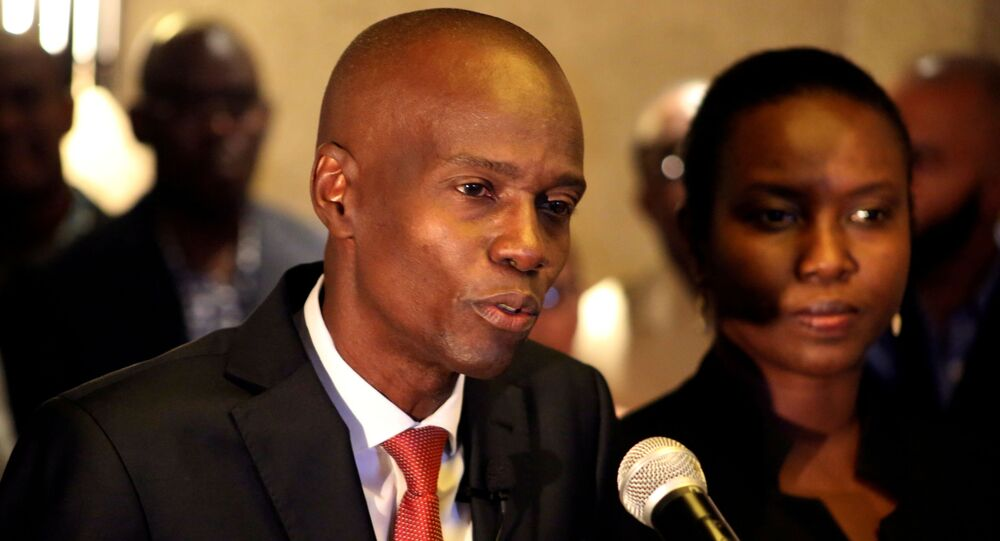 FILE PHOTO: Jovenel Moise addresses the media next to his wife Martine after winning the 2016 presidential election, in Port-au-Prince, Haiti. Picture taken November 28, 2016
