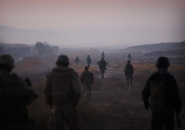 United States Marines from the 2nd Battalion 2nd Marines Warlords and Afghan National Army soldiers walk in formation during an operation in the Garmsir district of the volatile Helmand province, southern Afghanistan, Wednesday, Dec. 23, 2009
