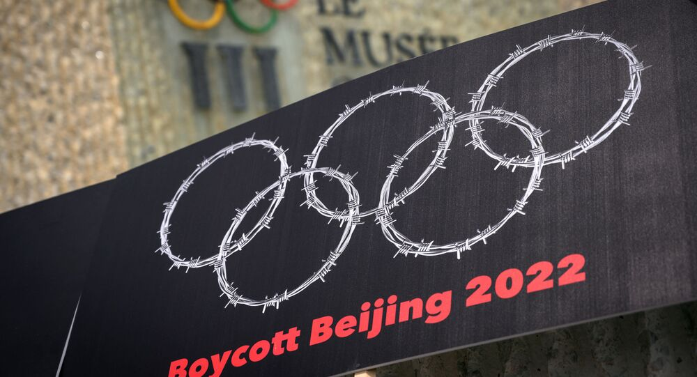 This photograph taken on June 23, 2021 shows a placard representing barber wire shaping and Olympics Rings are seen next to a sign of the Olympics Museum during a protest organised by Tibetan and Uyghur activists against Beijing 2022 Winter Olympics, in Lausanne as some 200 participants took part to the protest.