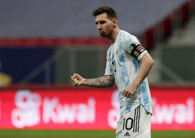 Soccer Football - Copa America 2021 - Semi Final - Argentina v Colombia - Estadio Mane Garrincha, Brasilia, Brazil - July 6, 2021 Argentina's Lionel Messi celebrates after scoring a penalty during the shootout