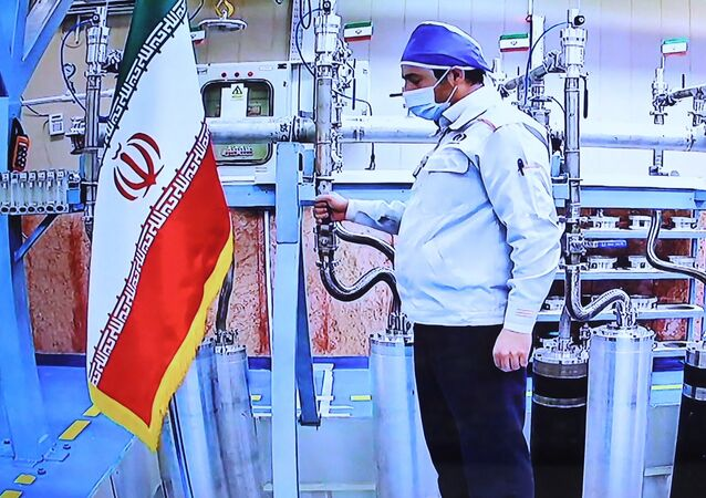 A handout picture provided by the Iranian presidential office on April 10, 2021, shows a grab of a videoconference screen of an enginere inside Iran's Natanz uranium enrichment plant, shown during a ceremony headed by the country's president on Iran's National Nuclear Technology Day, in the capital Tehran