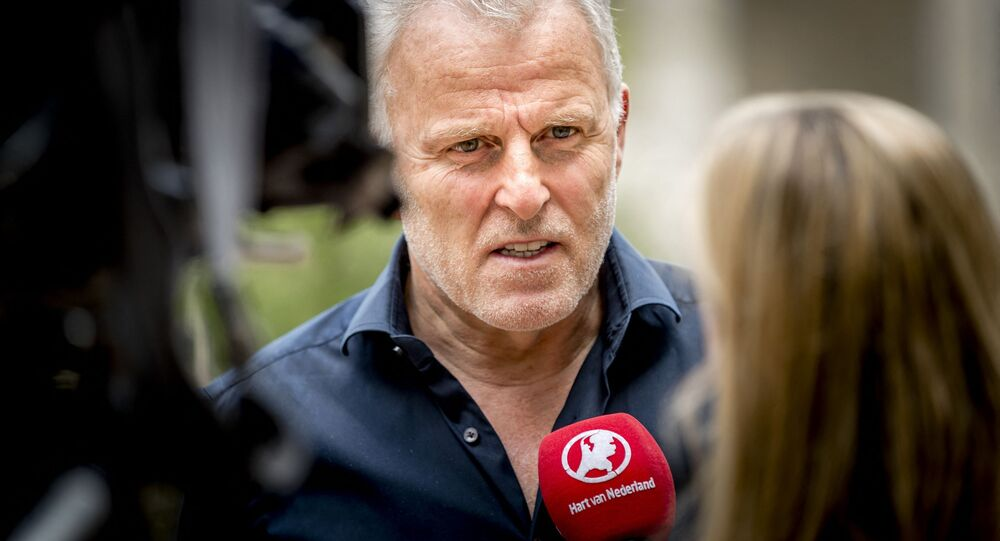 In this photograph taken on May 24, 2017, Dutch crime reporter Peter R. de Vries speaks with media representatives in Arnhem. - A well-known Dutch crime reporter  was rushed to hospital with gunshot wounds on July 6, 2021