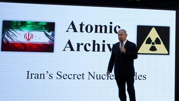Israeli Prime Minister Benjamin Netanyahu presents material on Iranian nuclear weapons development during a press conference in Tel Aviv, Monday, April 30 2018 - Sputnik International