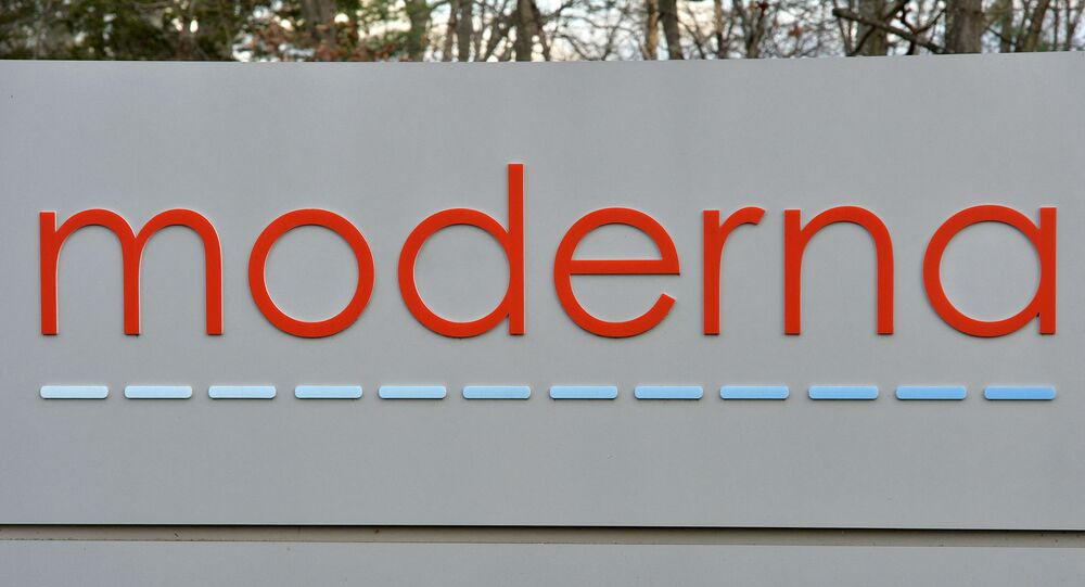 In this file photo the Moderna logo is seen at the Moderna campus in Norwood, Massachusetts on on December 2, 2020, where the biotechnology company is mass producing its Covid-19 vaccine. - US biotech firm Moderna said on July 7, 2021 it had dosed its first participants in a human study of an mRNA vaccine that targets multiple strains of influenza. The company intends to recruit 180 adults in the United States for the Phase 1/2 portion of the trial to evaluate the safety and strength of immune response to the shot, called mRNA-1010.