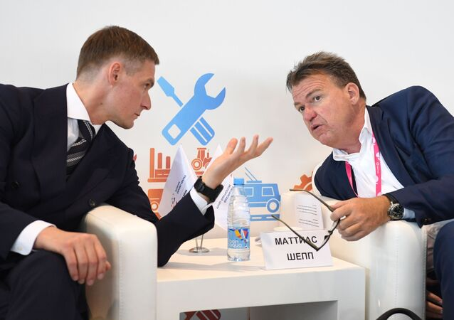 Andrey Sobolev, Russian Federation Trade Representative to Germany, and Matthias Schepp, Chairman of the German-Russian Chamber of Commerce Abroad.
