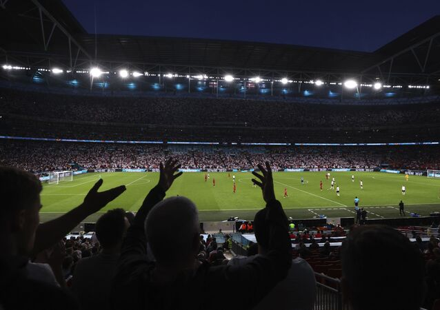 Fans react during the Euro 2020 soccer championship semifinal match between England and Denmark at Wembley stadium in London, Wednesday, July 7, 2021.
