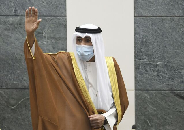 In this Sept. 30, 2020 file photo, the new Emir of Kuwait Sheikh Nawaf Al Ahmad Al Sabah, waves after he was sworn in at the Kuwaiti National Assembly. Kuwait said Thursday, March 4, 2021, that the 83-year-old ruling emir of Kuwait has flown to the United States for medical checks, just months after ascending the throne.