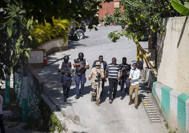 Security forces investigate the perimeters of the residence of Haitian President Jovenel Moise, in Port-au-Prince, Haiti, Wednesday, July 7, 2021.