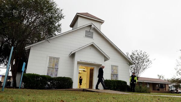 FILE - In this Nov. 12, 2017, file photo, a man walks out of the memorial for the victims of a shooting at Sutherland Springs First Baptist Church in Sutherland Springs, Texas. A judge will consolidate all federal lawsuits against the U.S. Air Force over the 2017 South Texas church shooting that killed more than two dozen worshippers. The gunman formerly was in the military. - Sputnik International
