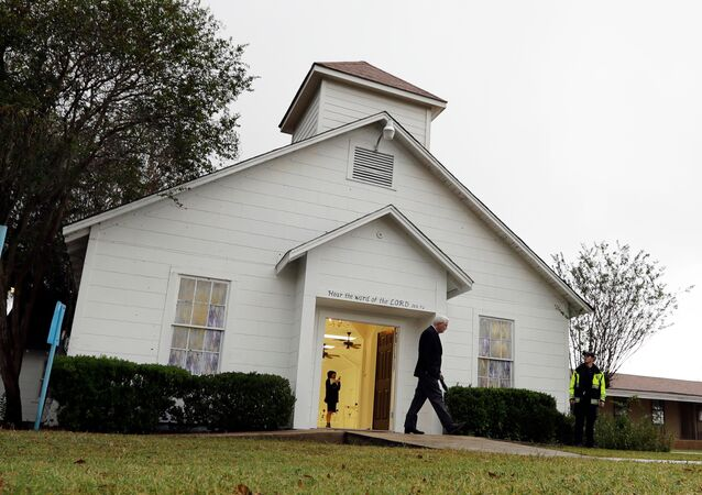 FILE - In this Nov. 12, 2017, file photo, a man walks out of the memorial for the victims of a shooting at Sutherland Springs First Baptist Church in Sutherland Springs, Texas. A judge will consolidate all federal lawsuits against the U.S. Air Force over the 2017 South Texas church shooting that killed more than two dozen worshippers. The gunman formerly was in the military.