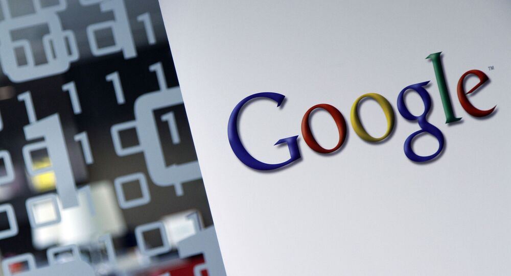 In this March 23, 2010, file photo, the Google logo is seen at the Google headquarters in Brussels. Germany's finance minister on Wednesday welcomed an agreement requiring large companies in the European Union to reveal how much tax they paid in which country.