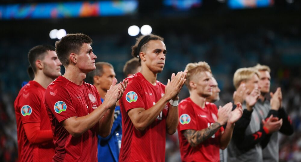 Soccer Football - Euro 2020 - Semi Final - England v Denmark - Wembley Stadium, London, Britain - July 7, 2021 Denmark's Joakim Maehle and Yussuf Poulsen with teammates applaud the fans after the match