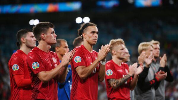 Soccer Football - Euro 2020 - Semi Final - England v Denmark - Wembley Stadium, London, Britain - July 7, 2021 Denmark's Joakim Maehle and Yussuf Poulsen with teammates applaud the fans after the match - Sputnik International