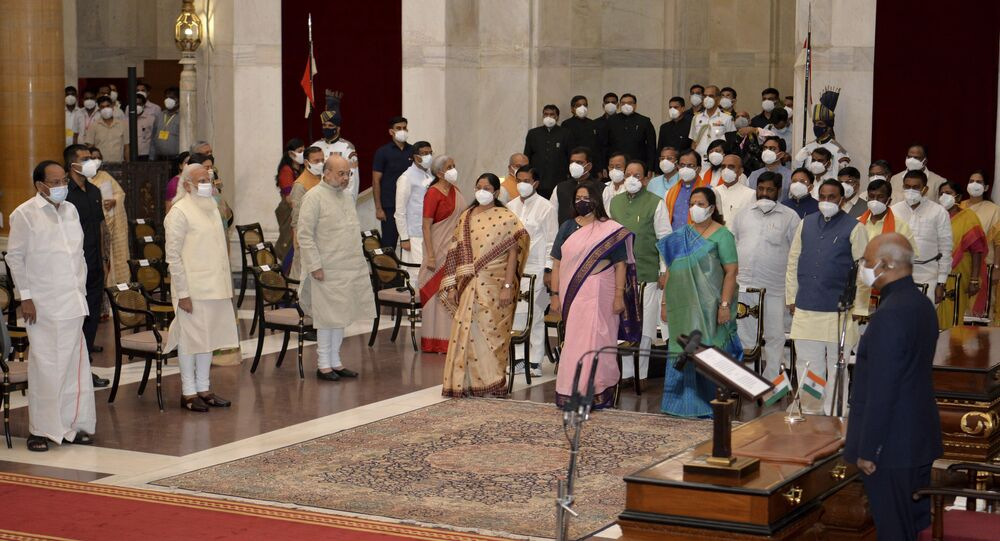 In this handout photo provided by the Indian Presidential Palace, the newly sworn in ministers, right, stand with Indian Prime Minister Narendra Modi, third left in front row, and other senior ministers during swearing in ceremony at the Presidential Palace in New Delhi, India, Wednesday, July 7, 2021.