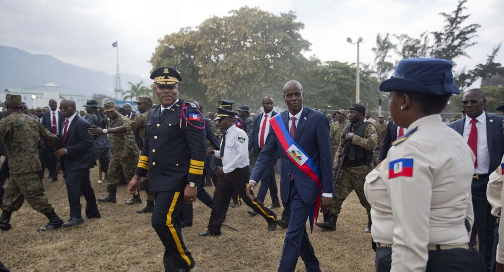 FILE - In this Feb. 7, 2017 file photo, newly sworn-in Haitian President Jovenel Moise walks with Police Chief Michel-Ange Gedeon past National Police at the National Palace after his inauguration ceremony at Parliament in Port-au-Prince, Haiti.