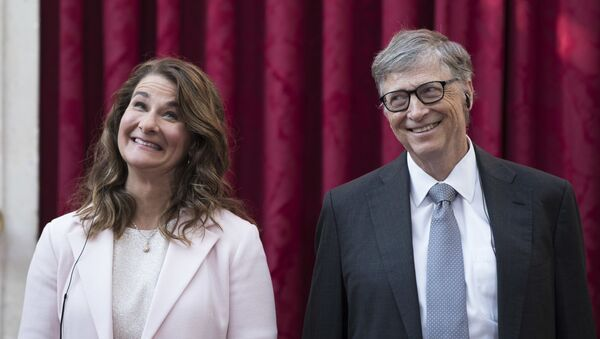 In this April 21, 2017, file photo, Philanthropist and co-founder of Microsoft, Bill Gates, right, and his wife Melinda react, prior to being awarded the Legion of Honour at the Elysee Palace in Paris - Sputnik International