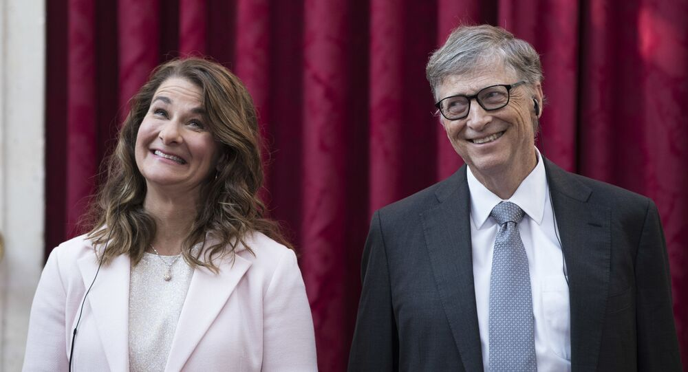 In this April 21, 2017, file photo, Philanthropist and co-founder of Microsoft, Bill Gates, right, and his wife Melinda react, prior to being awarded the Legion of Honour at the Elysee Palace in Paris