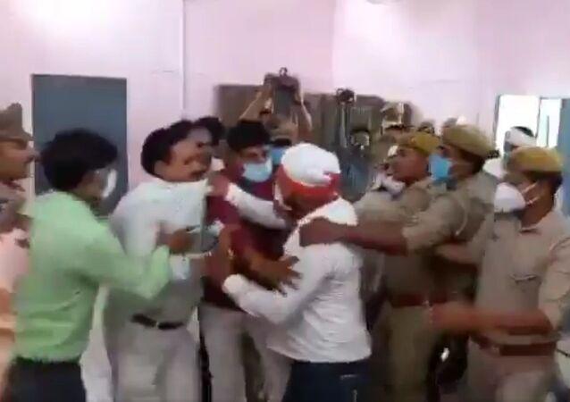 Visuals from Kannauj district in Uttar Pradesh. Brawl inside nomination hall in presence of police during block pramukh nominations