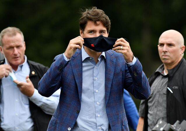Canada's Prime Minister Justin Trudeau puts on a face mask at Town Centre Park in Coquitlam, British Columbia, Canada July 8, 2021.