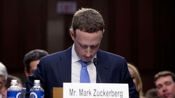 In this April 10, 2018, file photo Facebook CEO Mark Zuckerberg looks down as a break is called during his testimony before a joint hearing of the Commerce and Judiciary Committees on Capitol Hill in Washington. - Sputnik International