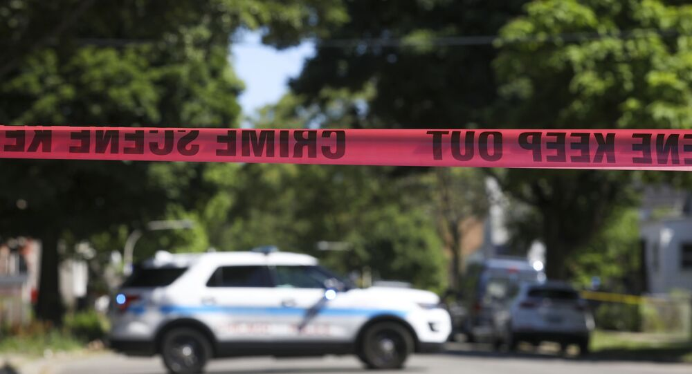 Police tape marks off a Chicago street as officers investigate the scene of a fatal shooting in the city's South Side on Tuesday, June 15, 2021. An argument in a house erupted into gunfire early Tuesday, police said.