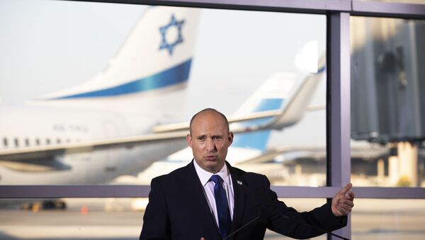 In this June 22, 2021 file photo, Israel's Prime Minister Naftali Bennett speaks to journalists after touring Ben Gurion Airport, with the Minister of Health Nitzan Horowitz and the Minister of Transportation Merav Michaeli. - Sputnik International