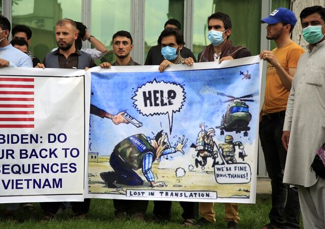 In this Friday, April 30, 2021, file photo former Afghan interpreters hold banners during a protest against the U.S. government and NATO in Kabul, Afghanistan.