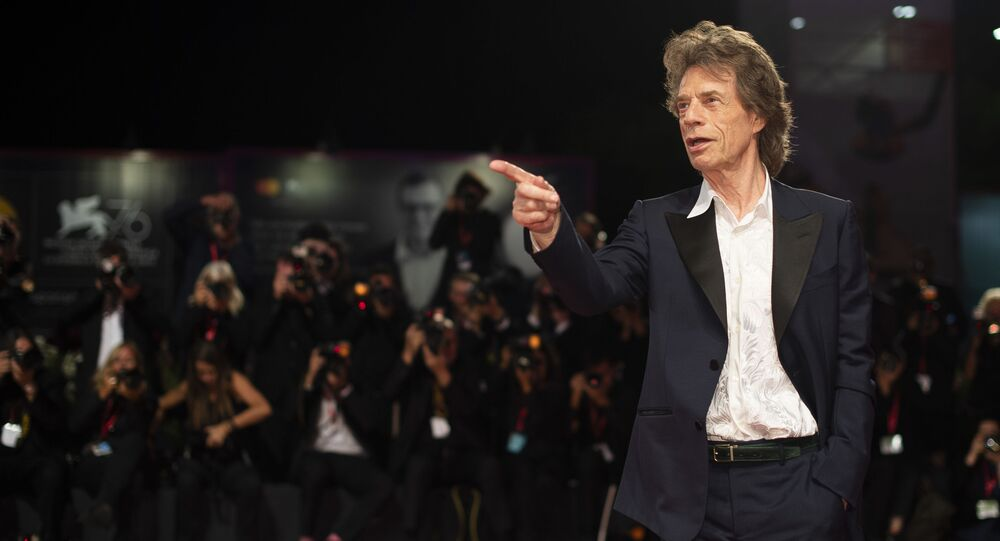 Actor Mick Jagger poses for photographers upon arrival at the premiere of the film 'The Burnt Orange Heresy' at the 76th edition of the Venice Film Festival, Venice, Italy, Saturday, Sept. 7, 2019.
