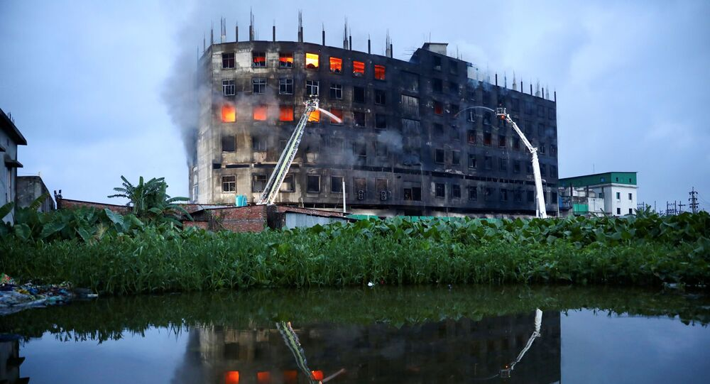Flames rise the morning after a fire broke out at a factory named Hashem Foods Ltd. in Rupganj of Narayanganj district, on the outskirts of Dhaka, Bangladesh, July 9, 2021