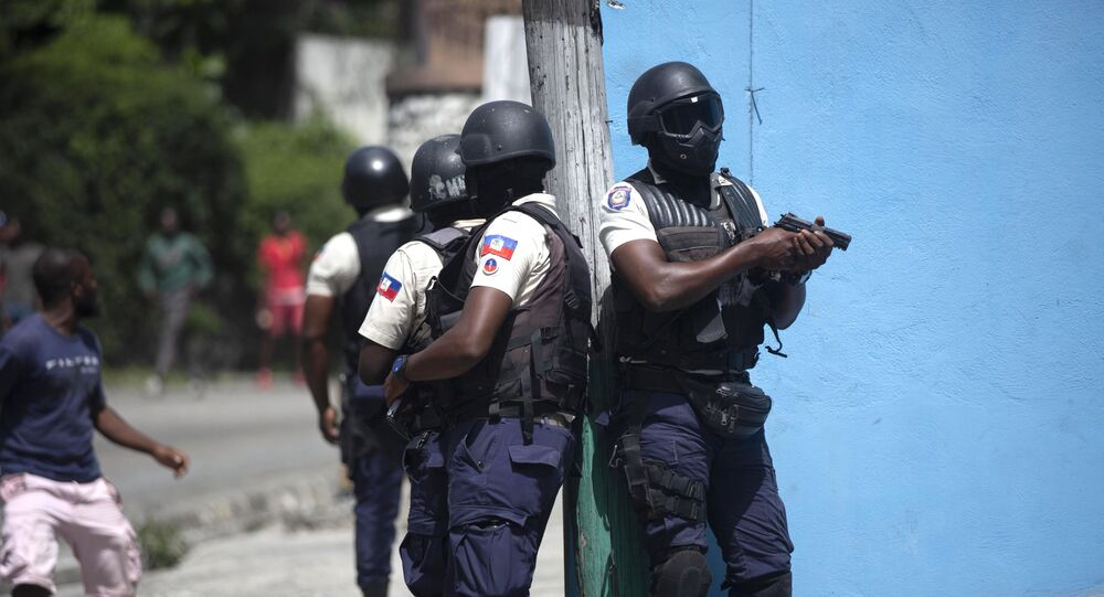 Police officers patrol in search for suspects in the murder Haiti's President Jovenel Moise, in Port-au-Prince, Haiti, Thursday, July 8, 2021. Moise was assassinated in an attack on his private residence early Wednesday.