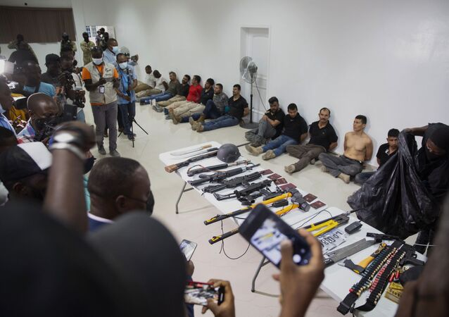 Suspects in the assassination of Haiti's President Jovenel Moise are shown to the media, along with the weapons and equipment they allegedly used in the attack, at the General Direction of the police in Port-au-Prince, Haiti, Thursday, July 8, 2021.