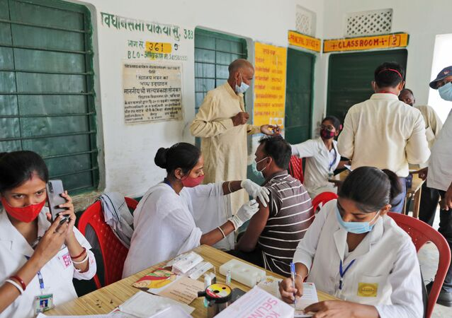 A vaccination drive against COVID-19 is in progress at a government school in Amritpur village, in Chandauli district, Uttar Pradesh state, India, Thursday, June 10, 2021