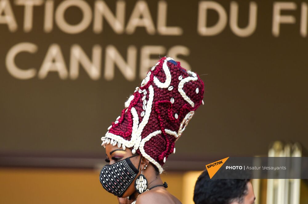 A woman wears an indigenous cap during the red carpet arrivals for the film Everything Went Fine.