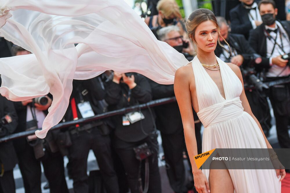 Model Noel Capri causes a stir on the Cannes 2021 red carpet appearing in a glittering cream dress.