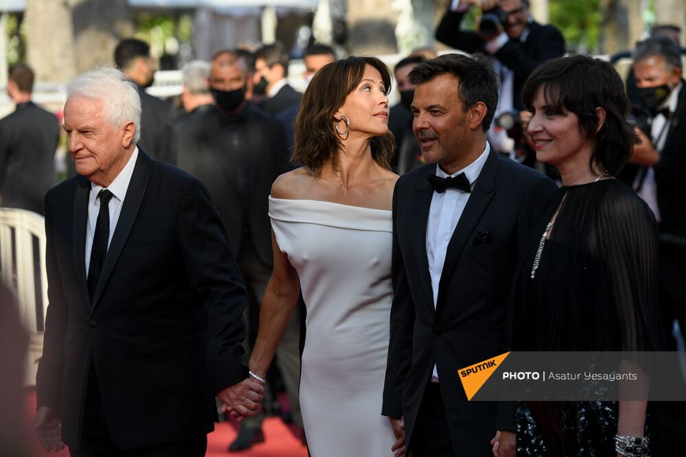 Andre Dussollier, Sophie Marceau, François Ozon, and Géraldine Pailhas in Chanel during the red carpet arrivals for the film Everything Went Fine.