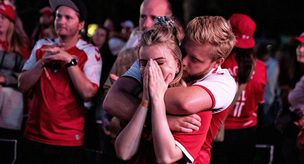 Soccer Football - Euro 2020 - Fans gather for England v Denmark - Kildeparken, Aalborg, Denmark - July 7, 2021 Denmark fans look dejected after losing the match