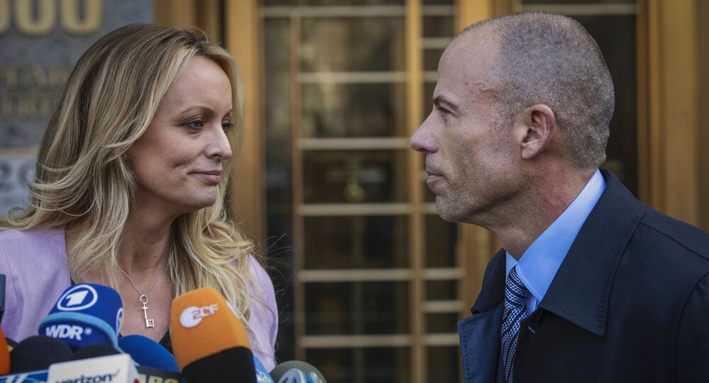 In this April 16, 2018, file photo, adult film actress Stormy Daniels, left, stands with her then lawyer, Michael Avenatti, during a press conference outside federal court in New York. A trial for Avenatti to face charges that he cheated ex-client Daniels out of proceeds from her book was delayed Friday, Jan. 8, 2021, until next year