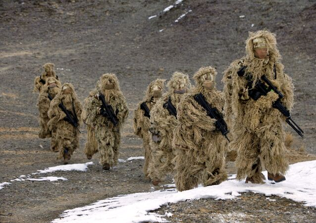 Soldiers of the People's Liberation Army (PLA) Marine Corps are seen in training at a military training base in Bayingol, Xinjiang Uighur Autonomous Region, January 20, 2016