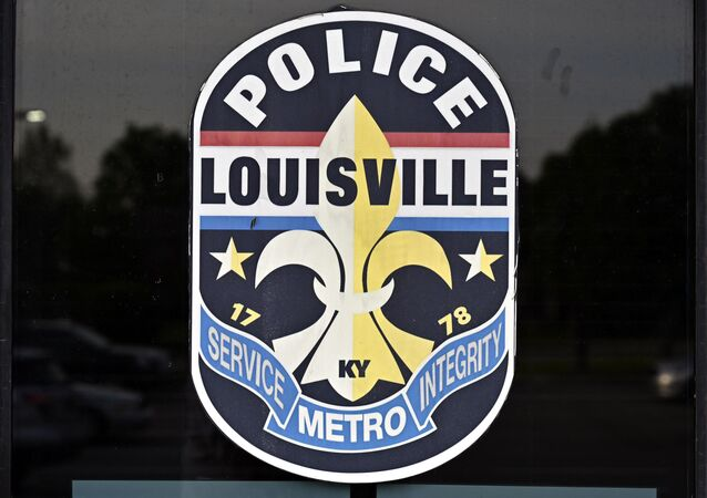 Photo of the insignia of the Louisville Metro Police Department on the door of the Second District station in Louisville, Kentucky, US on Tuesday, 27 April 2021.