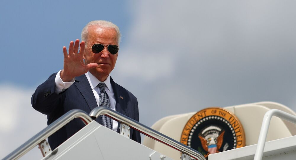 U.S. President Joe Biden waves to the media as he boards Air Force One at Joint Base Andrews in Maryland, U.S., July 9, 2021.