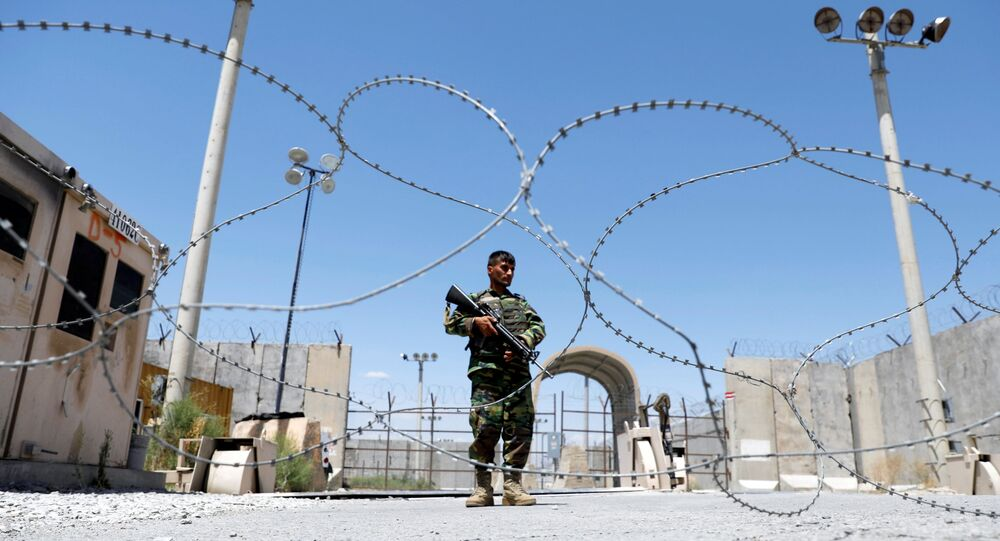 An Afghan National Army soldier stands guard at the gate of Bagram U.S. air base, on the day the last of American troops vacated it, Parwan province, Afghanistan July 2, 2021.