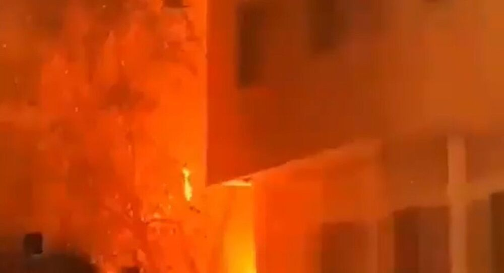 Screenshot captures a massive fire that consumed a residential building in the western district of Tehran, Iran. It is believed that the blaze was caused by a malfunction with the building's gas system; however, an investigation is ongoing.