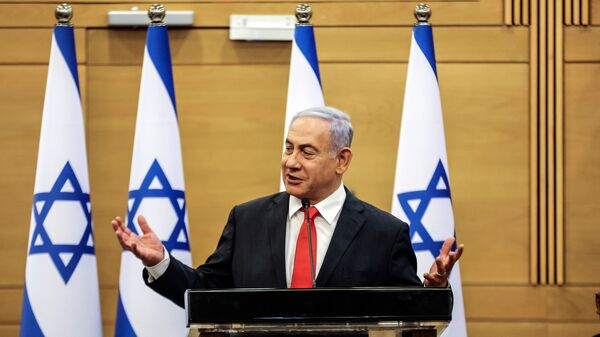 Leader of Israeli Opposition Benjamin Netanyahu speaks during a meeting with his Likud party in the Knesset, the Israeli parliament, in Jerusalem June 14, 2021.  - Sputnik International